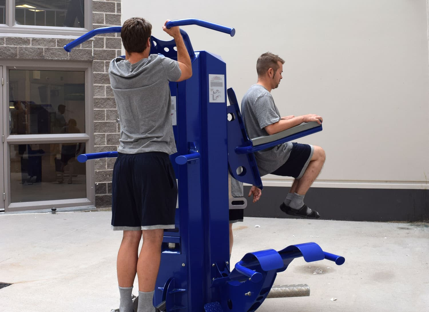 two inmates using apollo multigym indoors