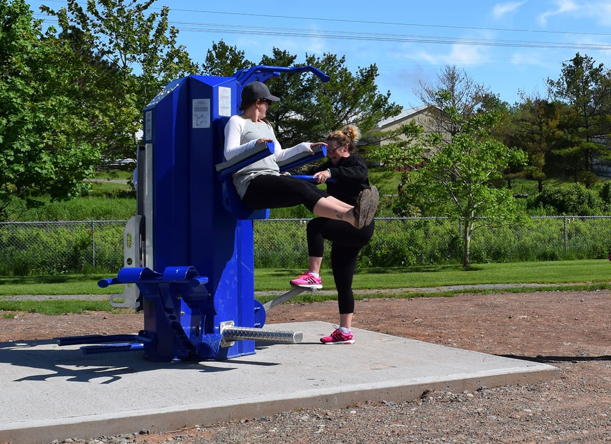 people using apollo fitness equipment in park